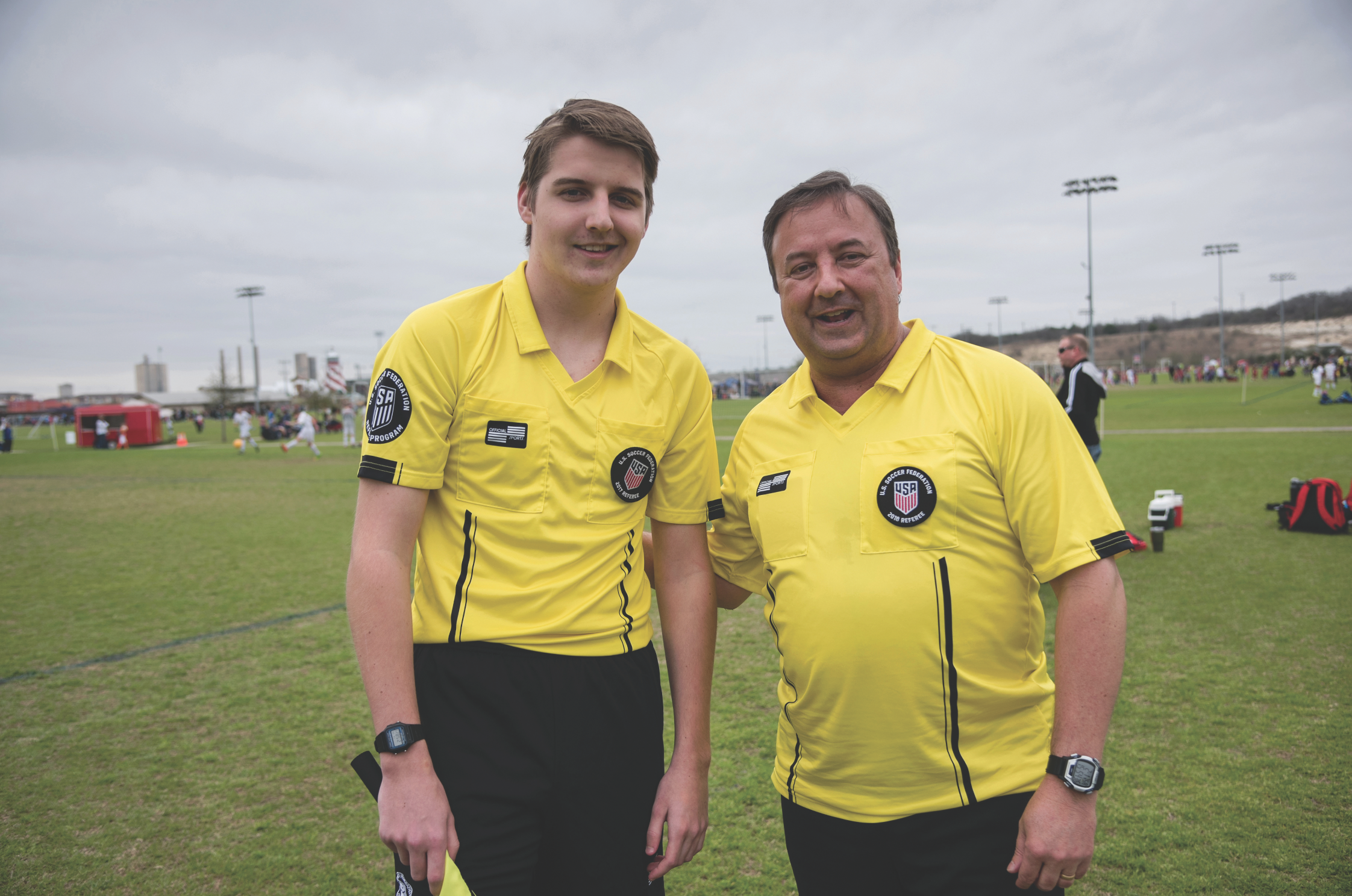 Michael Parker (right) and his son Zachary are involved with youth soccer and referee games on weekends.